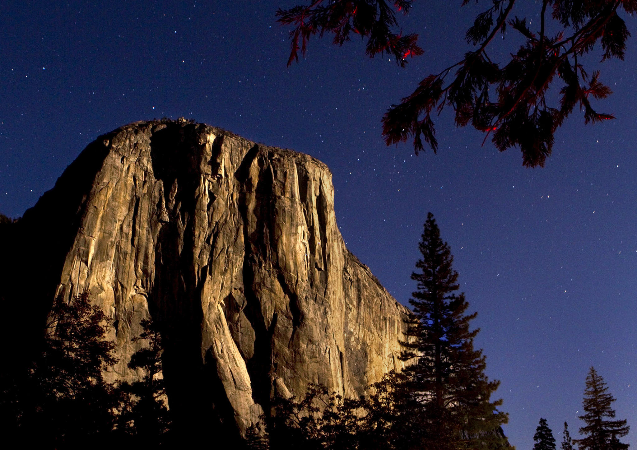 El Capitan strikes a majestic pose while bathed in the moonlight in Yosemite Valley.