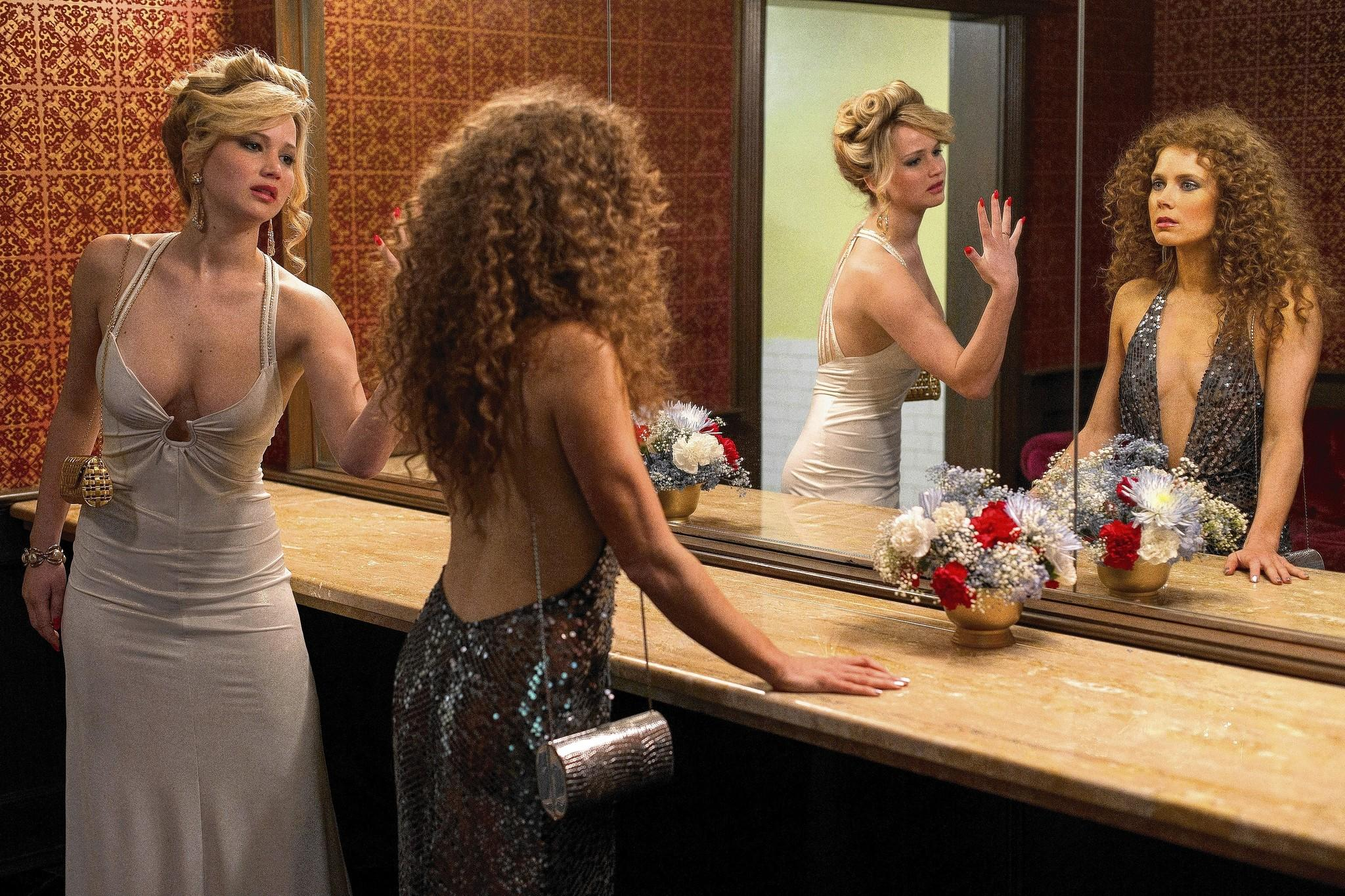 "Amy Adams and Jennifer Lawrence in ""American Hustle."""