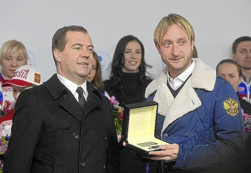 Russia's Prime Minister Medvedev and figure skating gold medal winner Plushenko attend ceremony to present automobiles to the Sochi 2014 Winter Olympics prize-holders representing Russia, by the Kremlin wall in central Moscow.