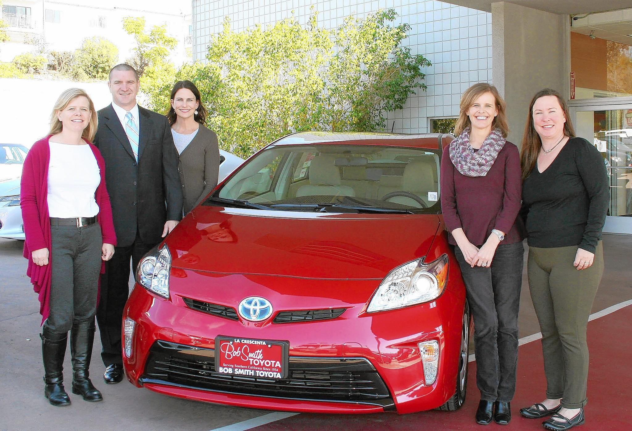 Raffle tickets for a Toyota Prius C are on sale now through the La Cañada Flintridge Educational Foundation and the lucky winner will be announced March 15 at the organization's annual Spring Gala. Shown with a Prius are gala co-chair Stephanie Fossan, from left, Bob Smith Toyota's Pete Smith, Deborah Weirick, executive director of the foundation; gala co-chair Kirsten Newquist and gala raffle chair Shannon Griffin.