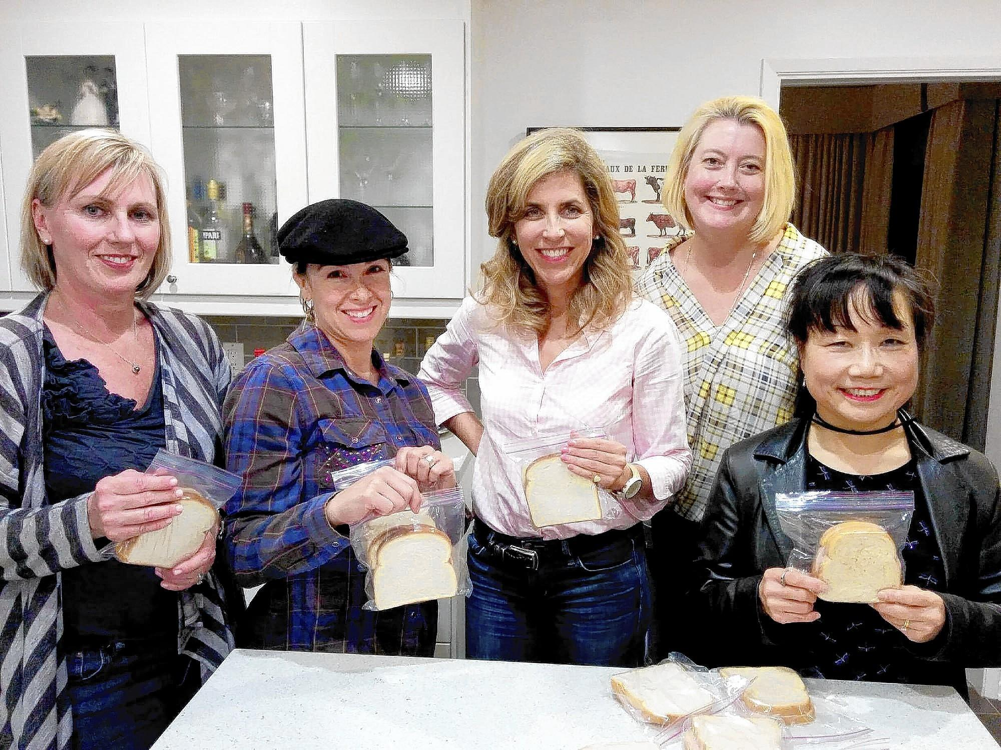 La Cañada Junior Women's Club members, from left, Kori Icardo, Lainie Rose-Miller, Kyle Grimes, Julie Del Rivo and Jenny Pass assemble sack lunches for its Meals on Heels program in support of Union Station in Pasadena.