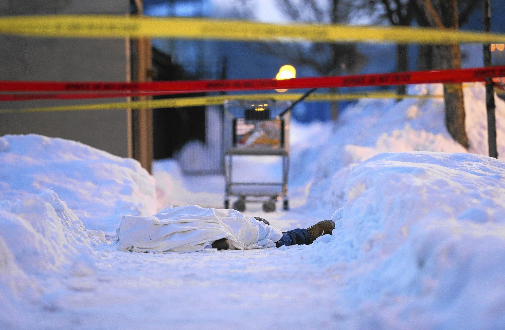 The body of a slaying victim lies on a sidewalk Feb. 9 in the 1300 block of West Hastings Avenue in Chicago.