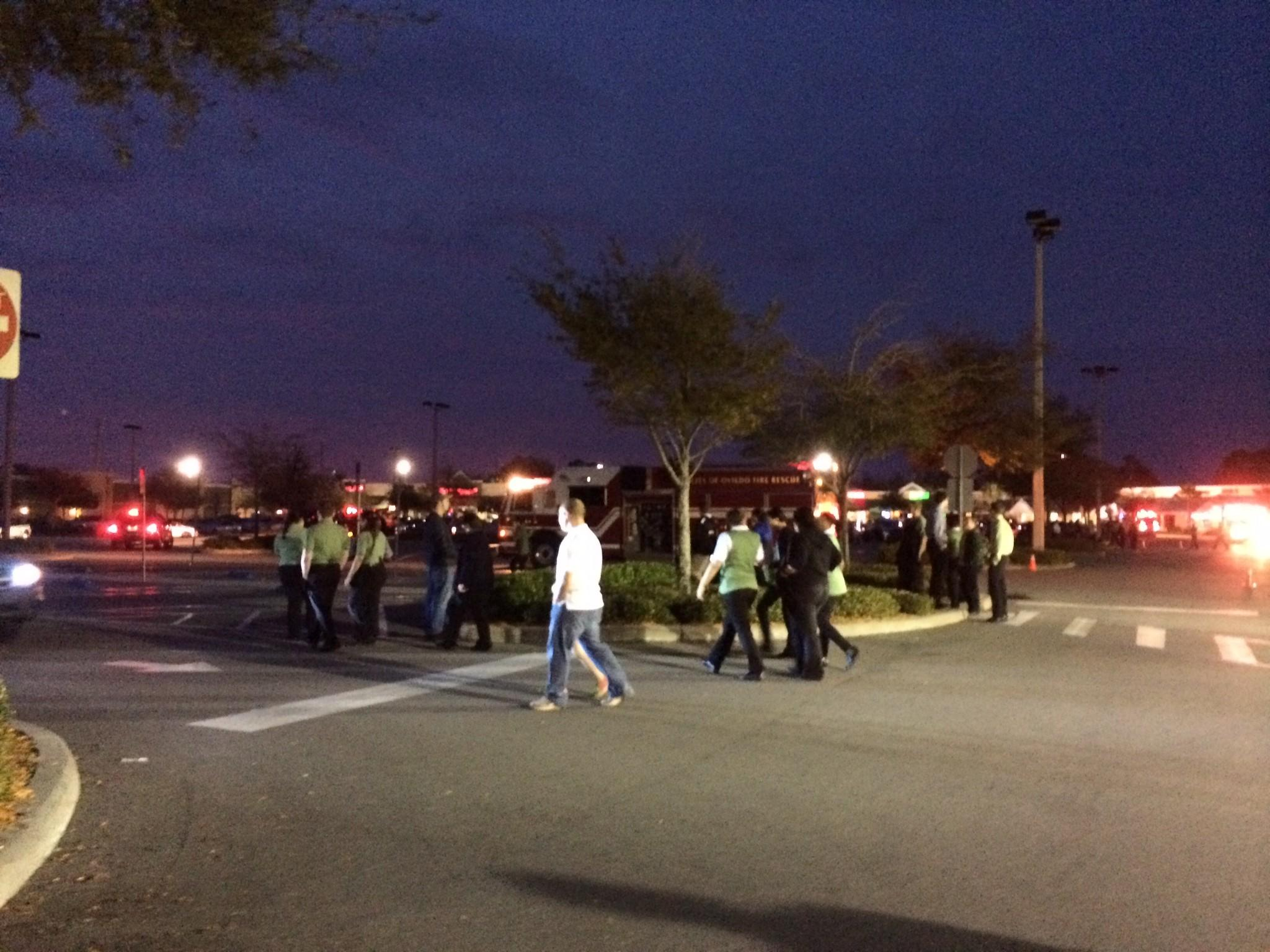 Publix employees outside of an Oviedo Publix that was evacuated because of a gas leak.