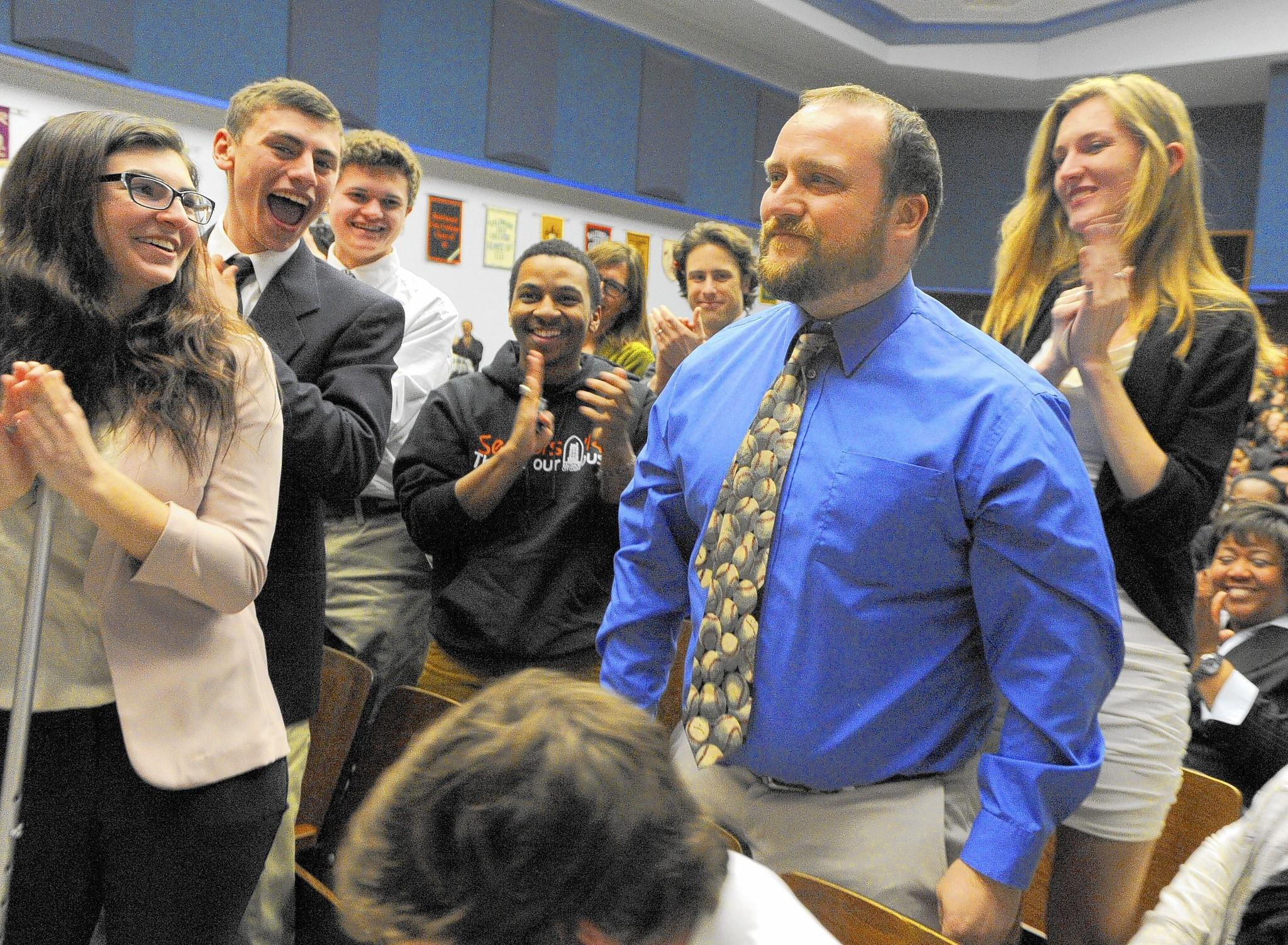 City College English teacher Mark Miazga is surprised with a $25,000 Milken Educator Award as some of his students cheer for him during the announcement.