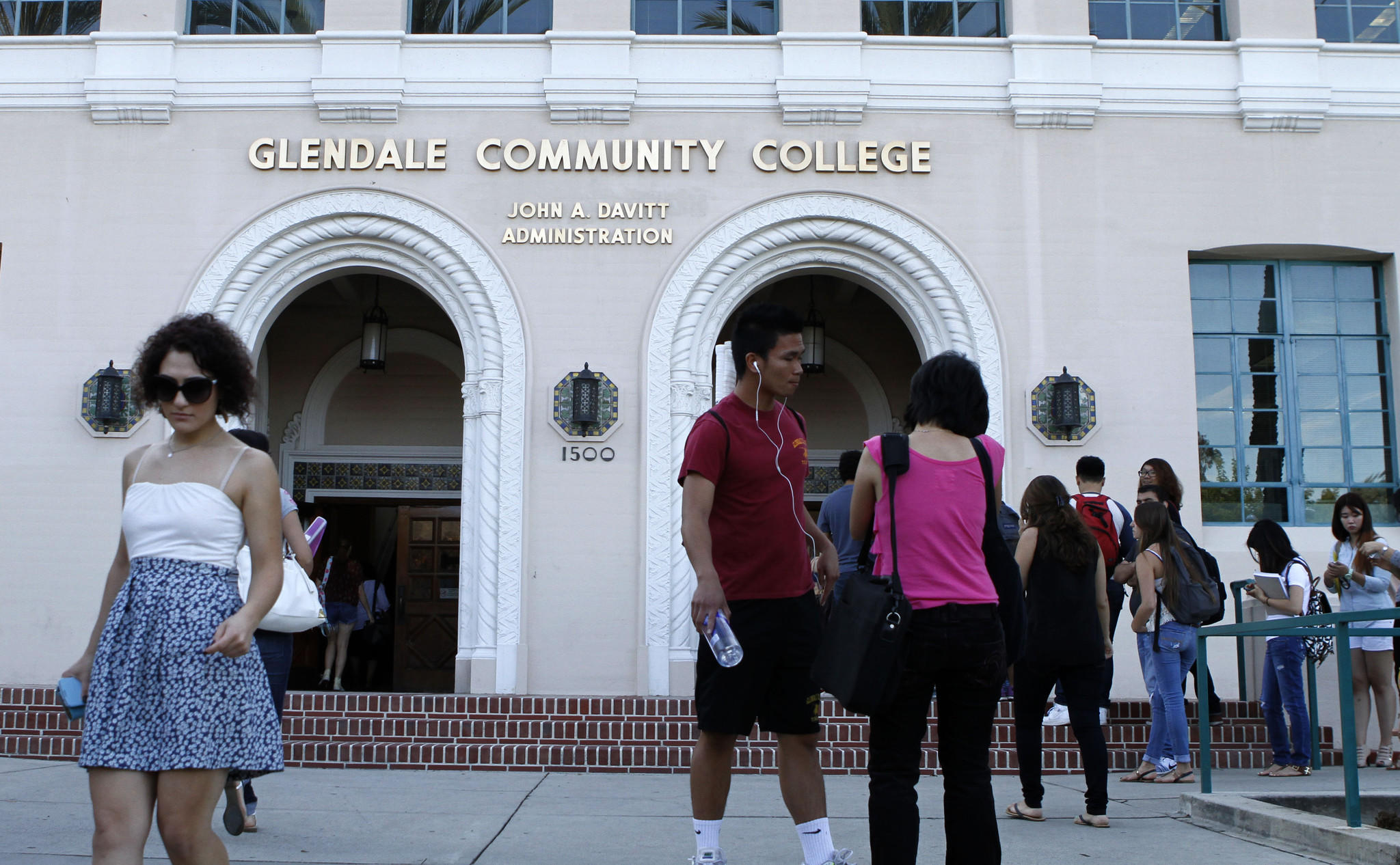 Some students rush to and from buildings as others wait in line on the first day of Fall classes at Glendale Community College on Tuesday, September 3, 2013.
