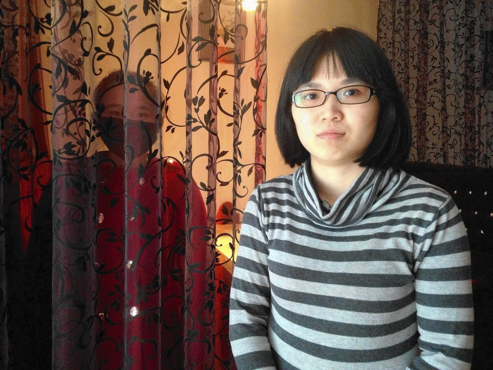 Cao Ju, left, and her attorney, Huang Yizhi, won China's first gender employment discrimination lawsuit.