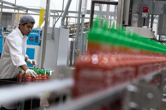 Jostein Reyes works in the packaging area at Huy Fong Foods Inc. in Irwindale. Huy Fong Foods Inc. is known for their Sriracha hot sauce.