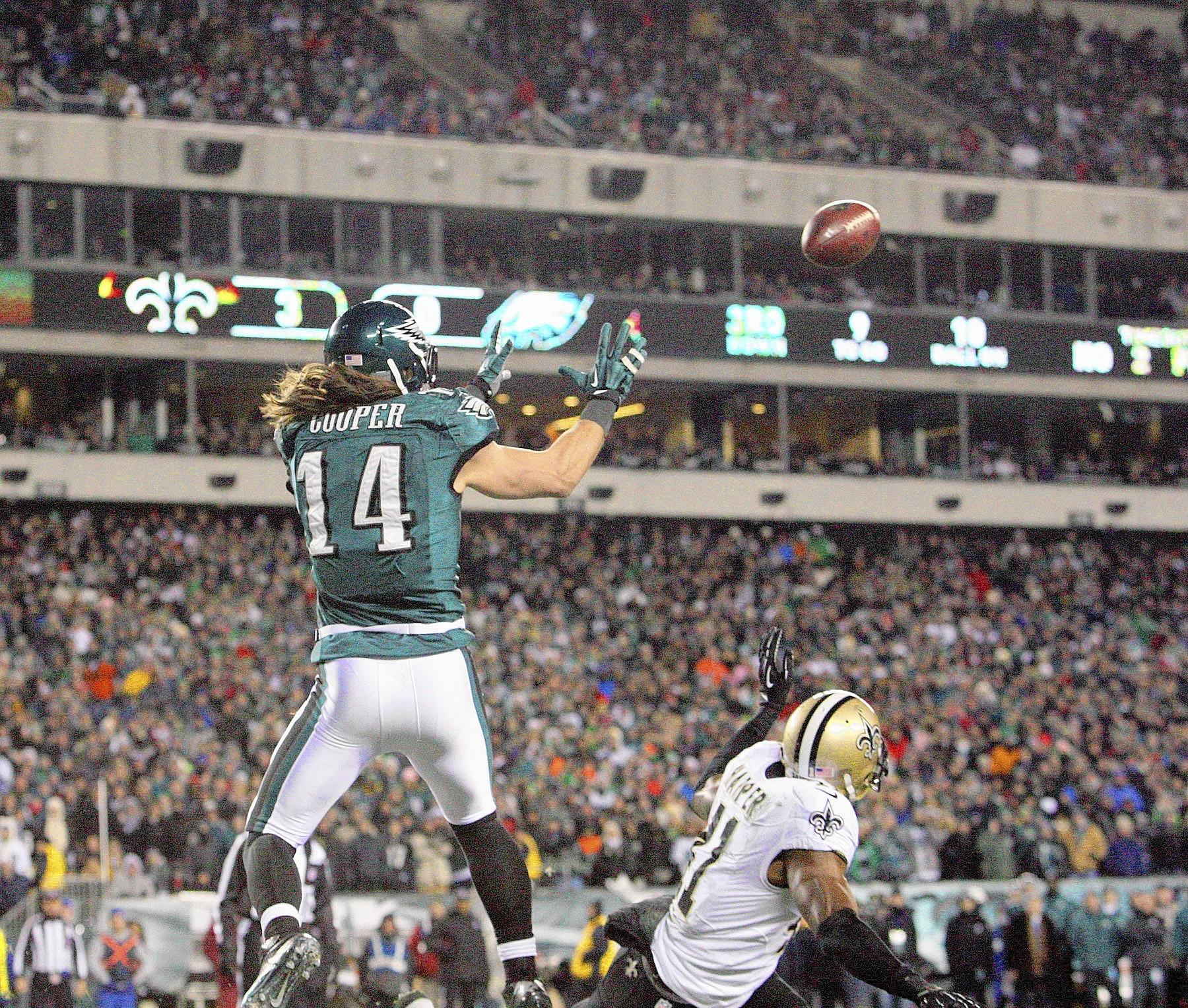 Philadelphia Eagles Riley Cooper (14) catches a touchdown pass against the New Orleans Saints during second half action of an NFC Wild card game Saturday, January 4, 2014 at Lincoln Financial Field in Philadelphia.
