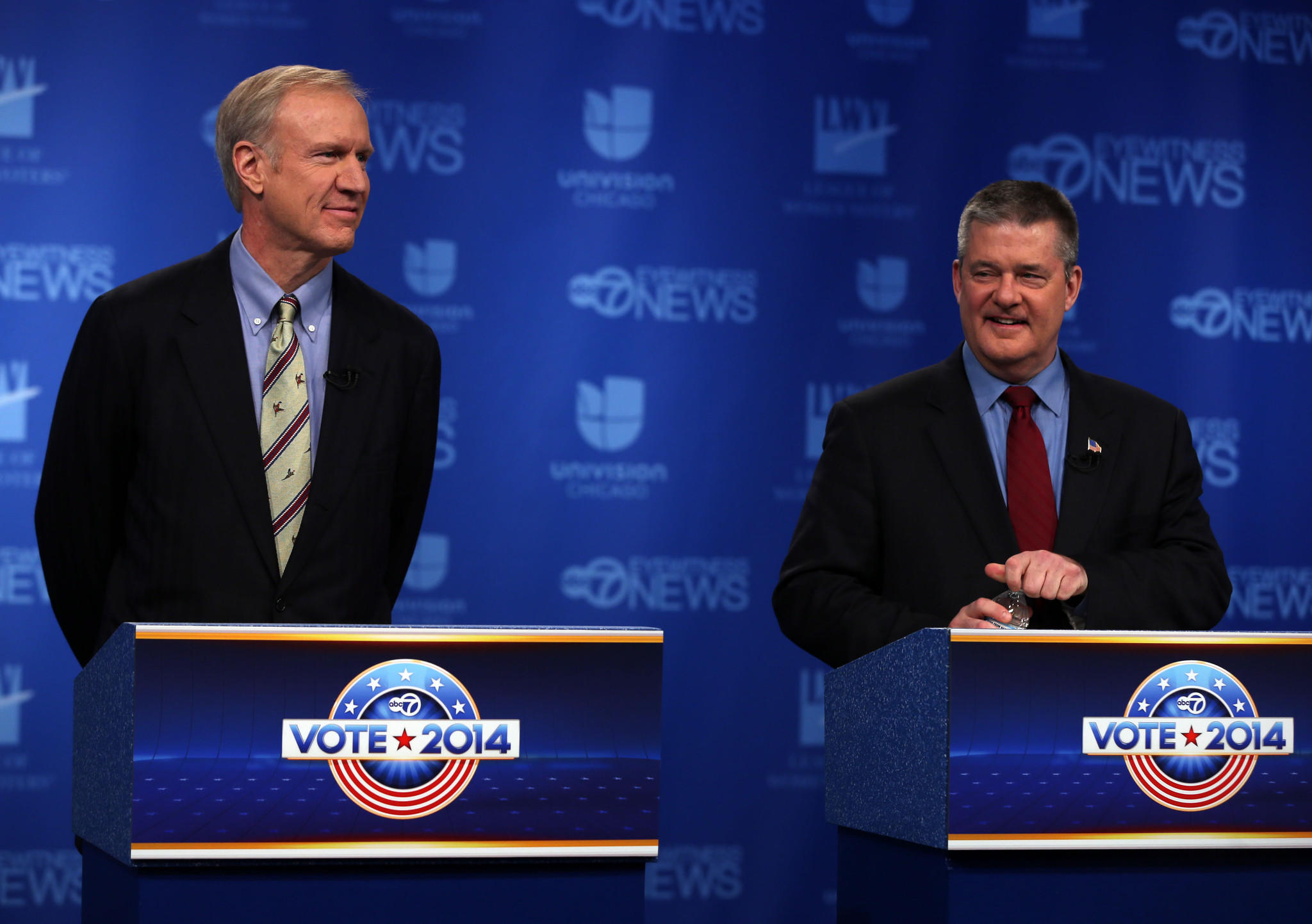 Republican candidates for governor of Illinois Bruce Rauner, left, and Dan Rutherford prepare to debate each other in an ABC television studio in Chicago on Thursday, February 27, 2014.