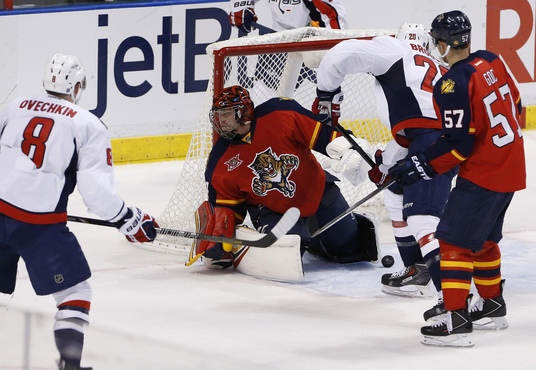 Washington Capitals right wing Troy Brouwer (20) scores a goal against Florida Panthers goalie Tim Thomas.
