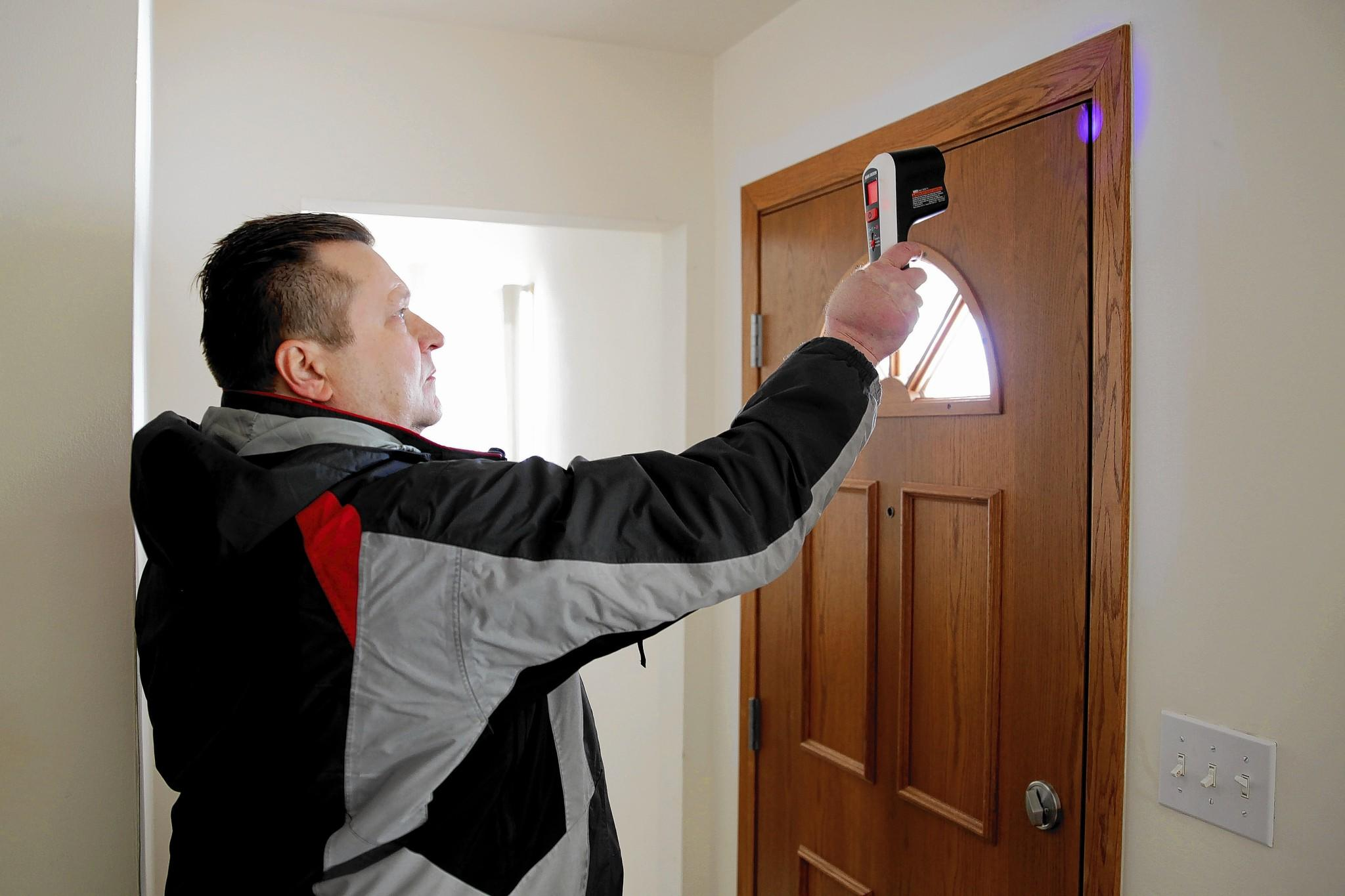 Superior Paul Wayland Uses A Thermal Leak Detector To Measure Heat Loss Around His  Mother In