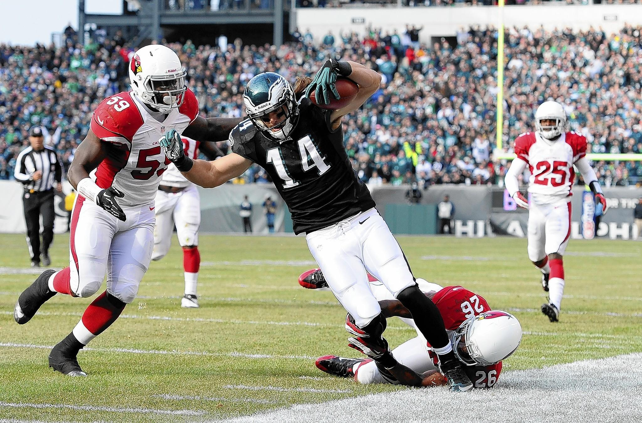 PHILADELPHIA, PA - DECEMBER 01: Riley Cooper #14 of the Philadelphia Eagles is tackled by Rashad Johnson #26 of the Arizona Cardinals and Marcus Benard #59 during the second quarter at Lincoln Financial Field on December 1, 2013 in Philadelphia, Pennsylvania. (