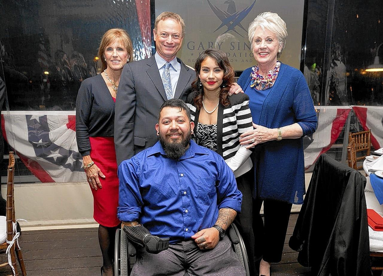 An evening assisting wounded veterans attracted Sally Crockett, Gary Sinise, Alexis and Juan Dominguez and Margaret Larkin.