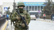 Russian gunmen patrol airports in tense Crimean standoff