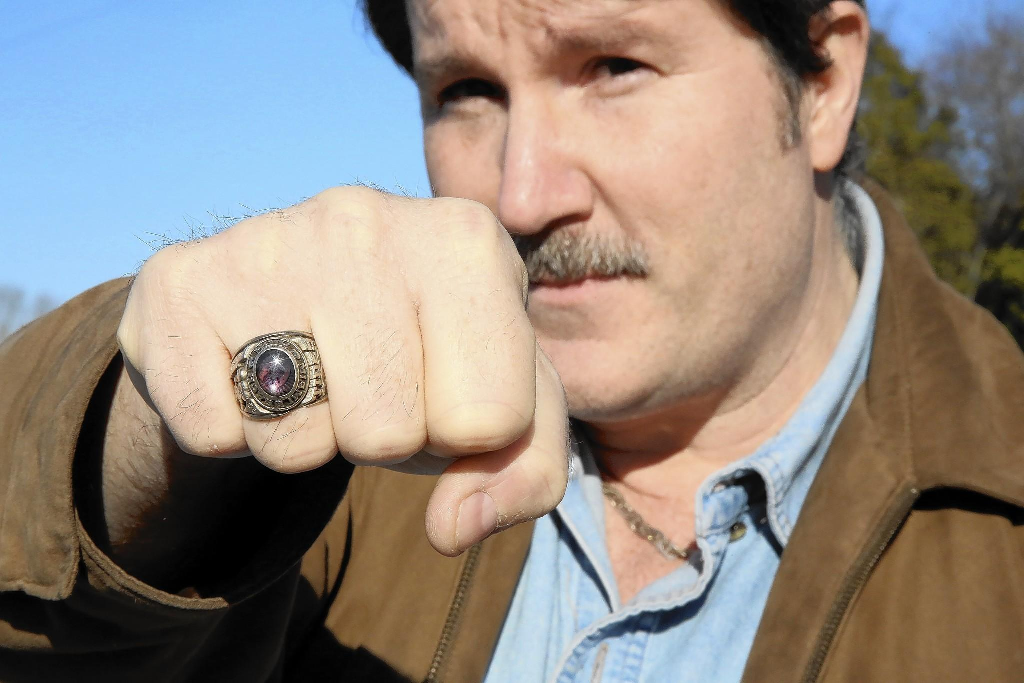 John Sims displays his retruned ring.