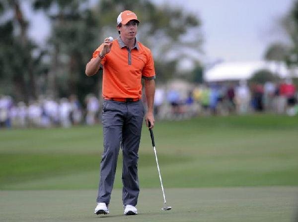Rory McIlroy acknoledges the gallery after birdieing 18 and finishing the opening round of The Honda Classic at seven under par Thursday.