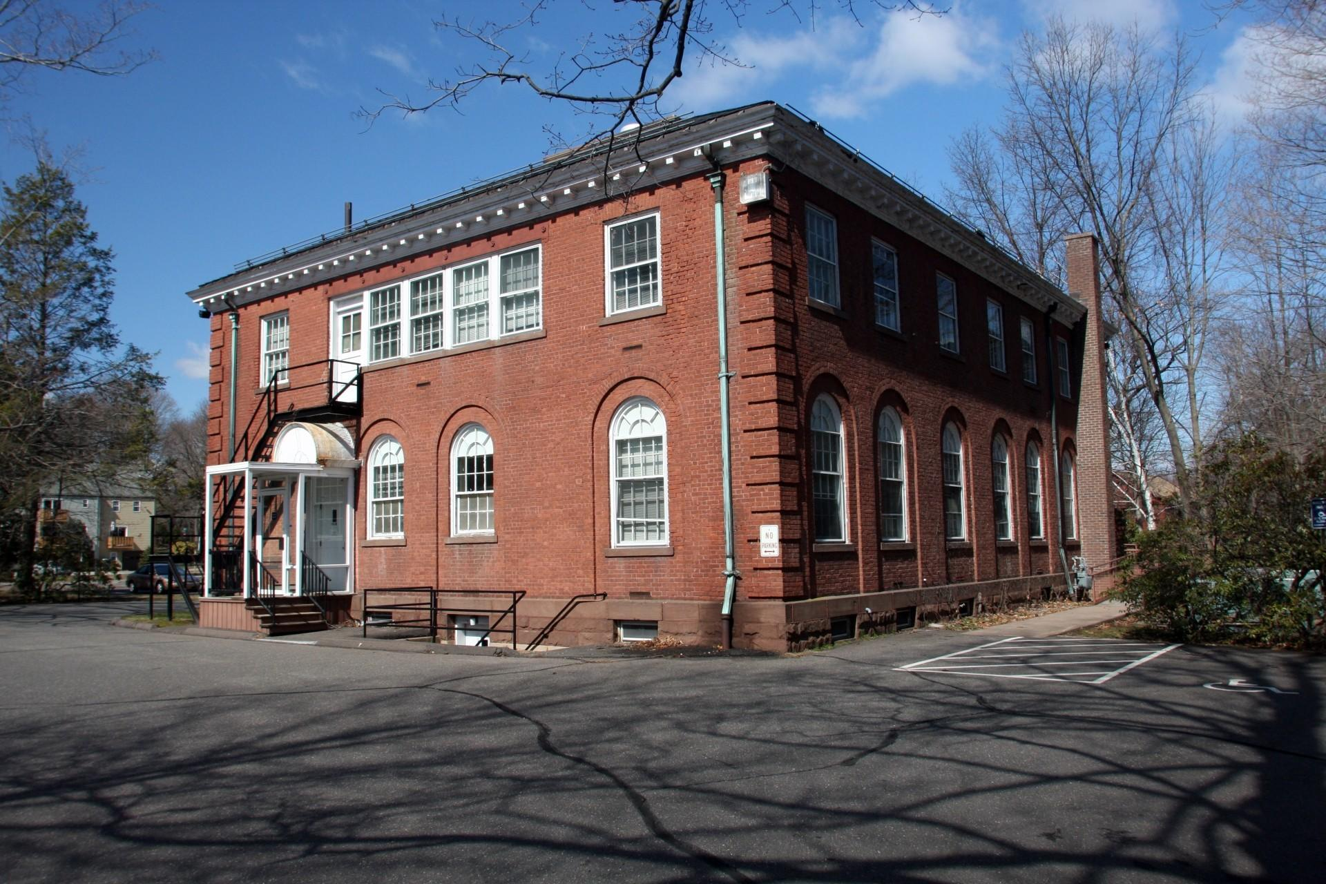 The former board of education building is back on the market.