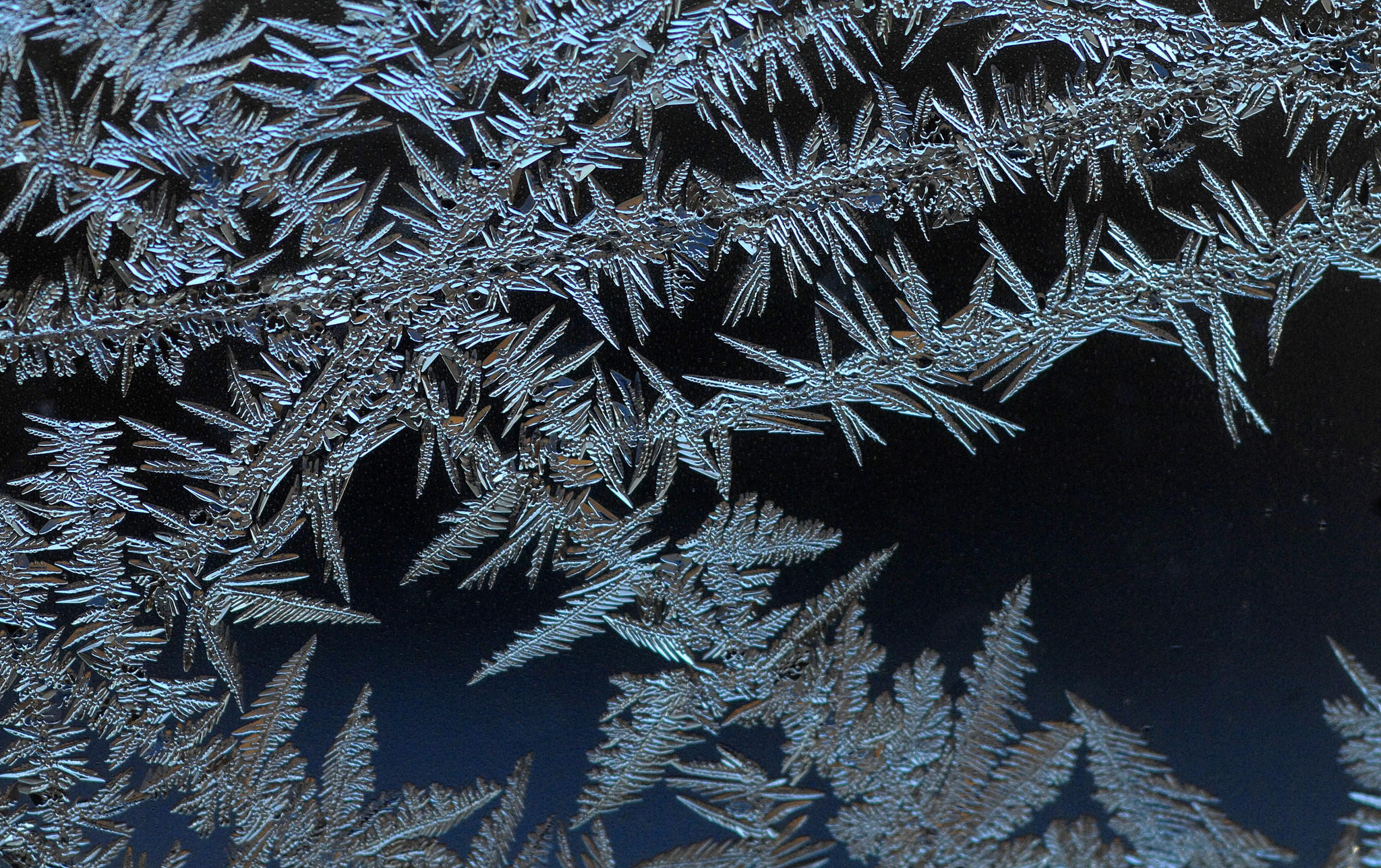 Ice crystals are seen on a window on another cold February morning in Baltimore.