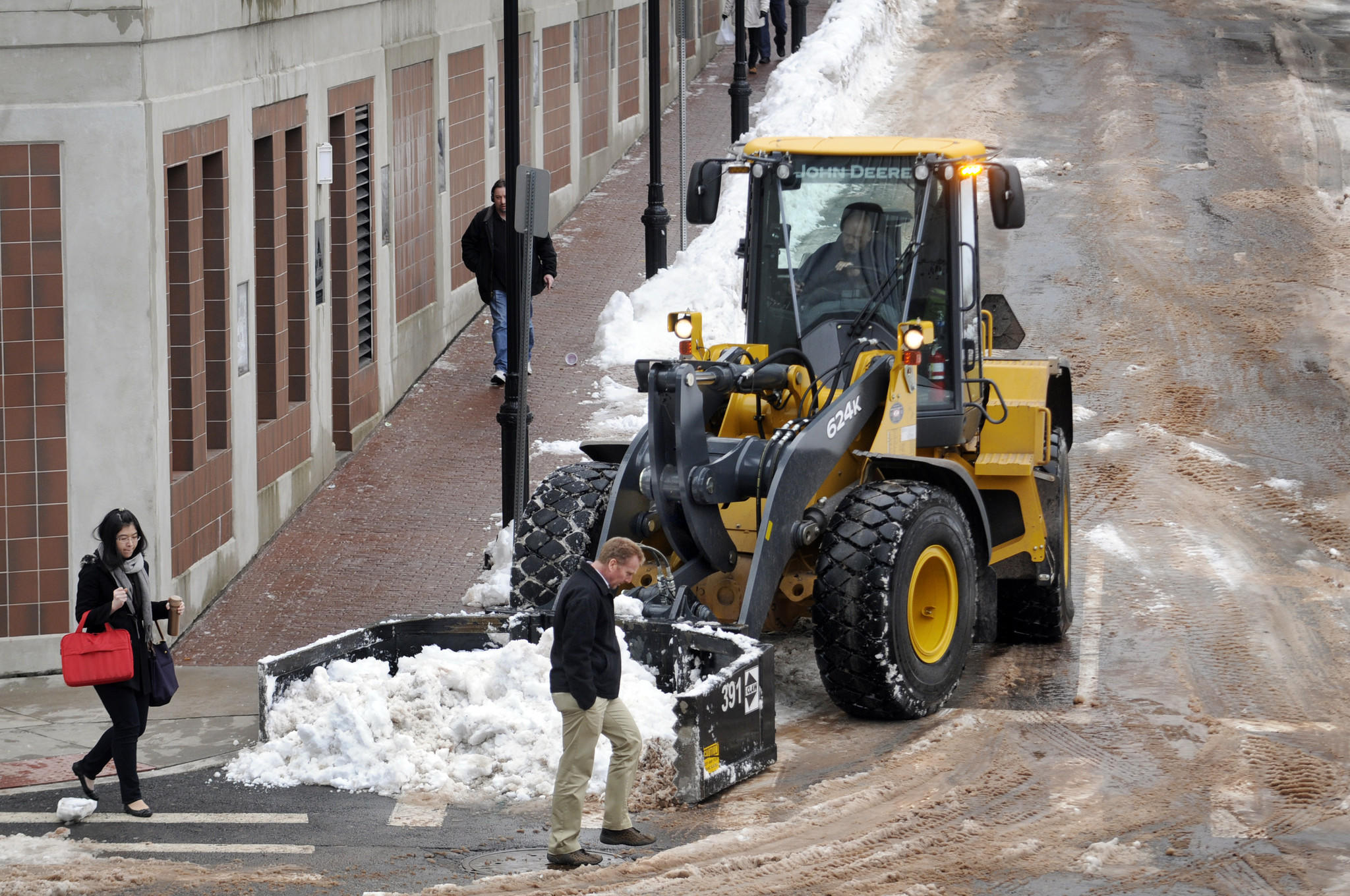 Hartford brought out their heavy equipment to clear the streets downtown Thursday after the latest snowfall that left many streets very narrow due to the mountains of snow.