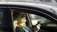 Looking at your cellphone while driving should be illegal too