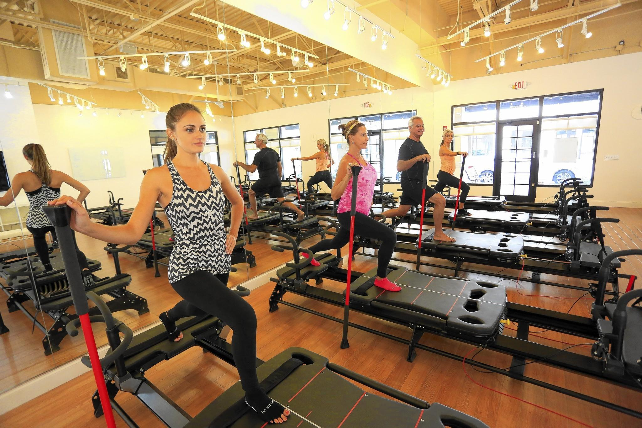 Core Evolution owner Marina Perrone leads a Lagree pilates class at her Palm Beach Gardens facility, using the MegaFormer machines.