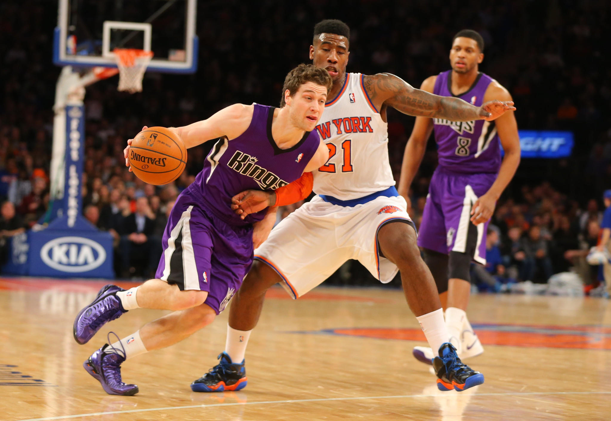 Sacramento Kings point guard Jimmer Fredette drives to the basket against the New York Knicks.