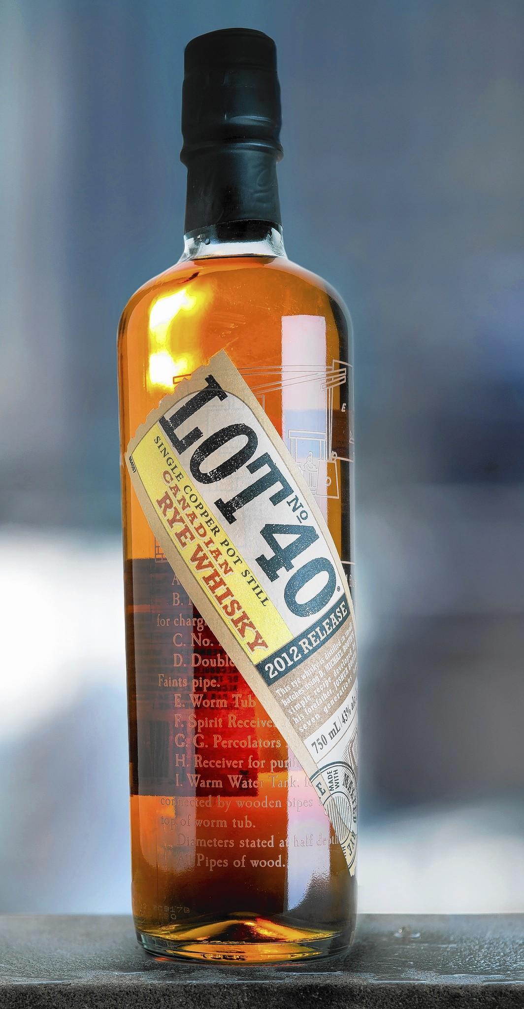 A bottle of Lot #40 Canadian Rye Whisky.