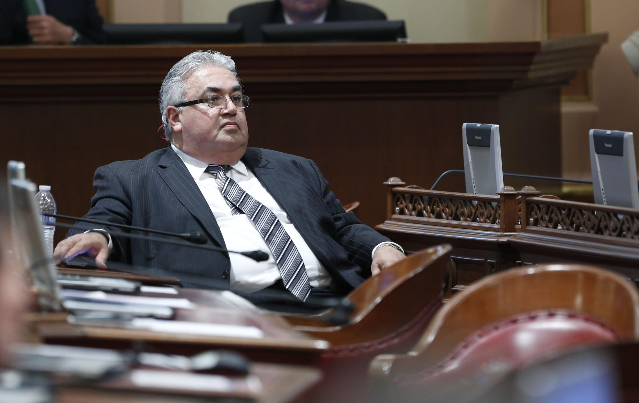 State Sen. Ron Calderon, pictured on the Senate floor in January, announced Sunday that he was taking a leave of absence while he fights a 24-county federal indictment.