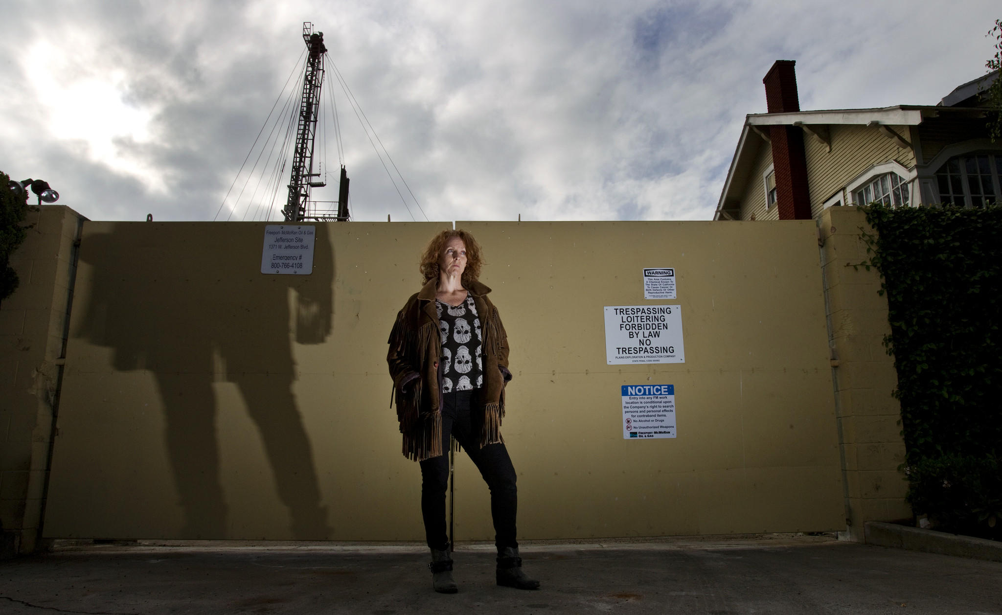 "Donna Ann Ward, founder of Cowatching Oil L.A., wants the city to ban acidizing and other ""well stimulation"" practices at drilling sites like this one at Jefferson and Budlong avenues."