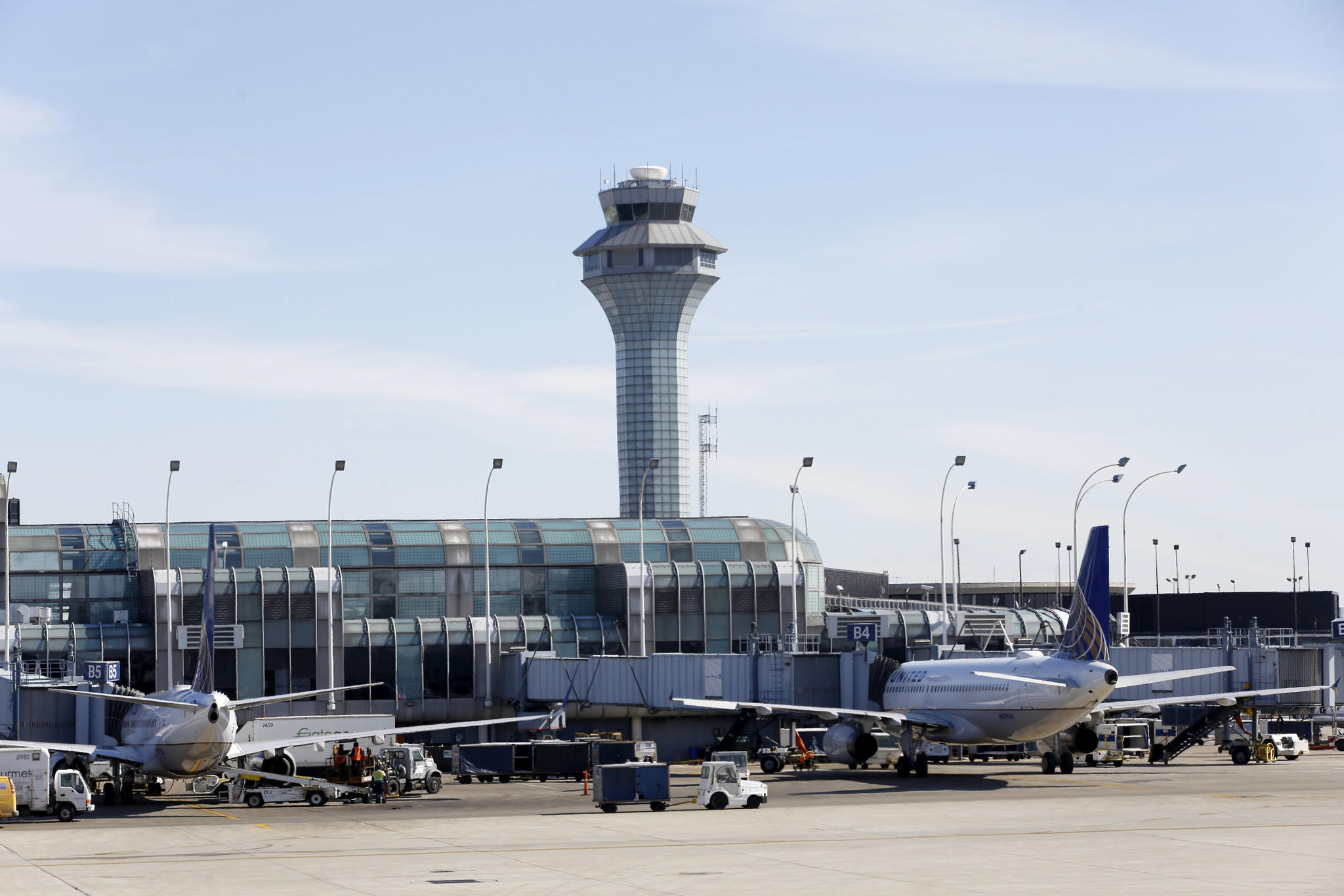 The control tower looms in the background with general runway and gate scenes at United Airline's terminal at O'Hare International Airport, Thursday, Feb. 27, 2014 in Chicago.