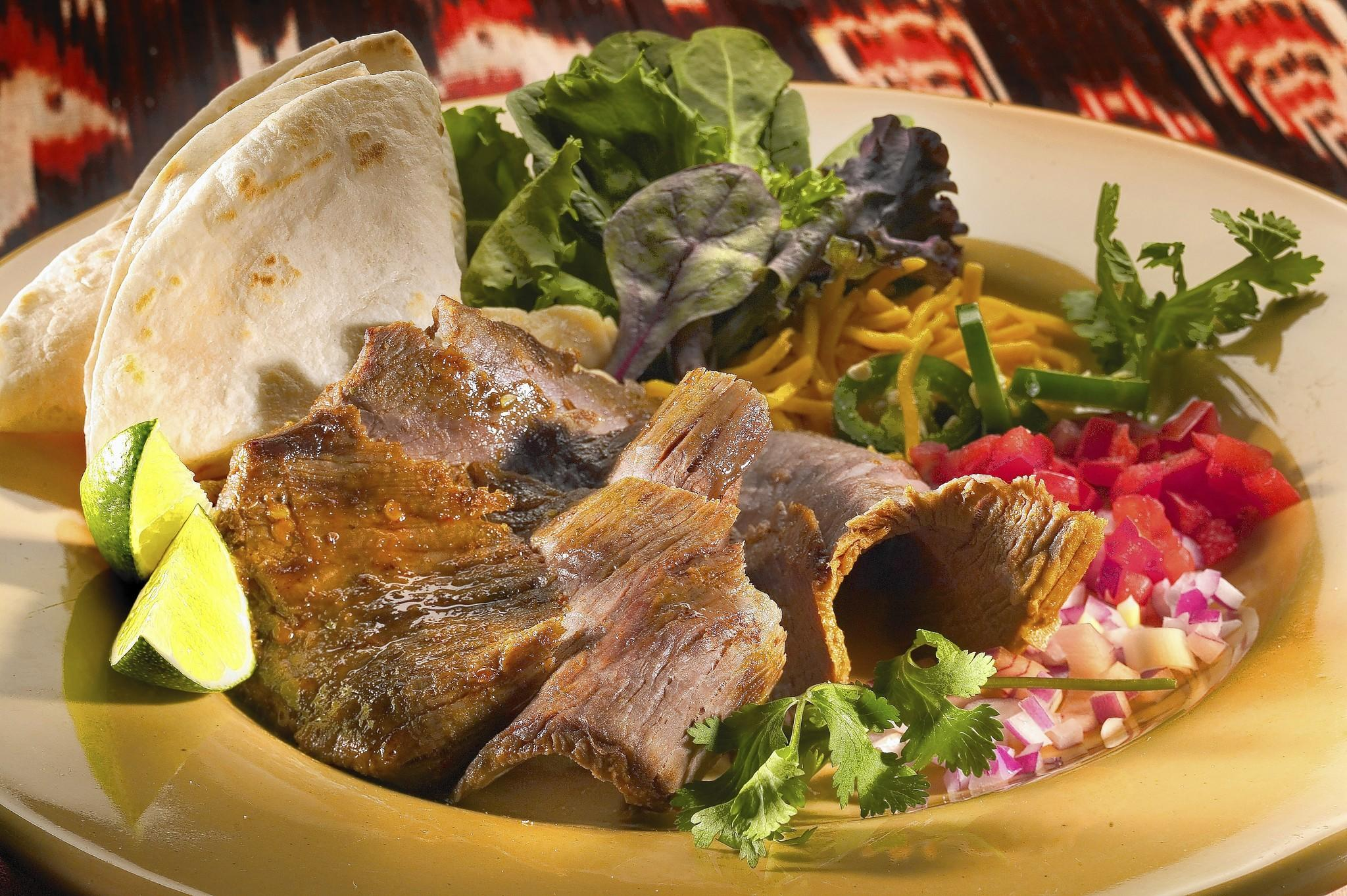 Chipotle-orange flank steak. Wrap the flank steak in warm tortillas and top with chopped onion or tomato, salsa, cilantro, grated cheese, avocado, a squirt of lime juice.