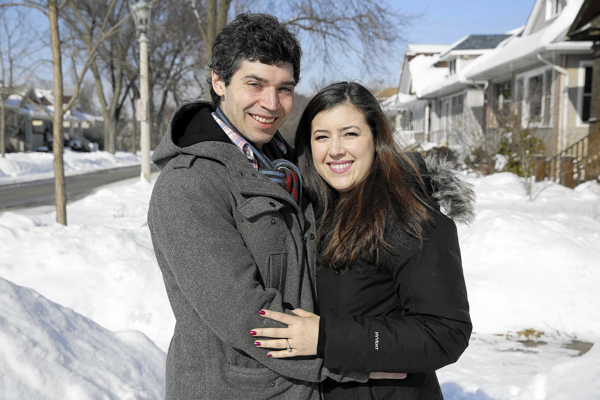 Christa Garza and Tyler Miller outside their Oak Park home.