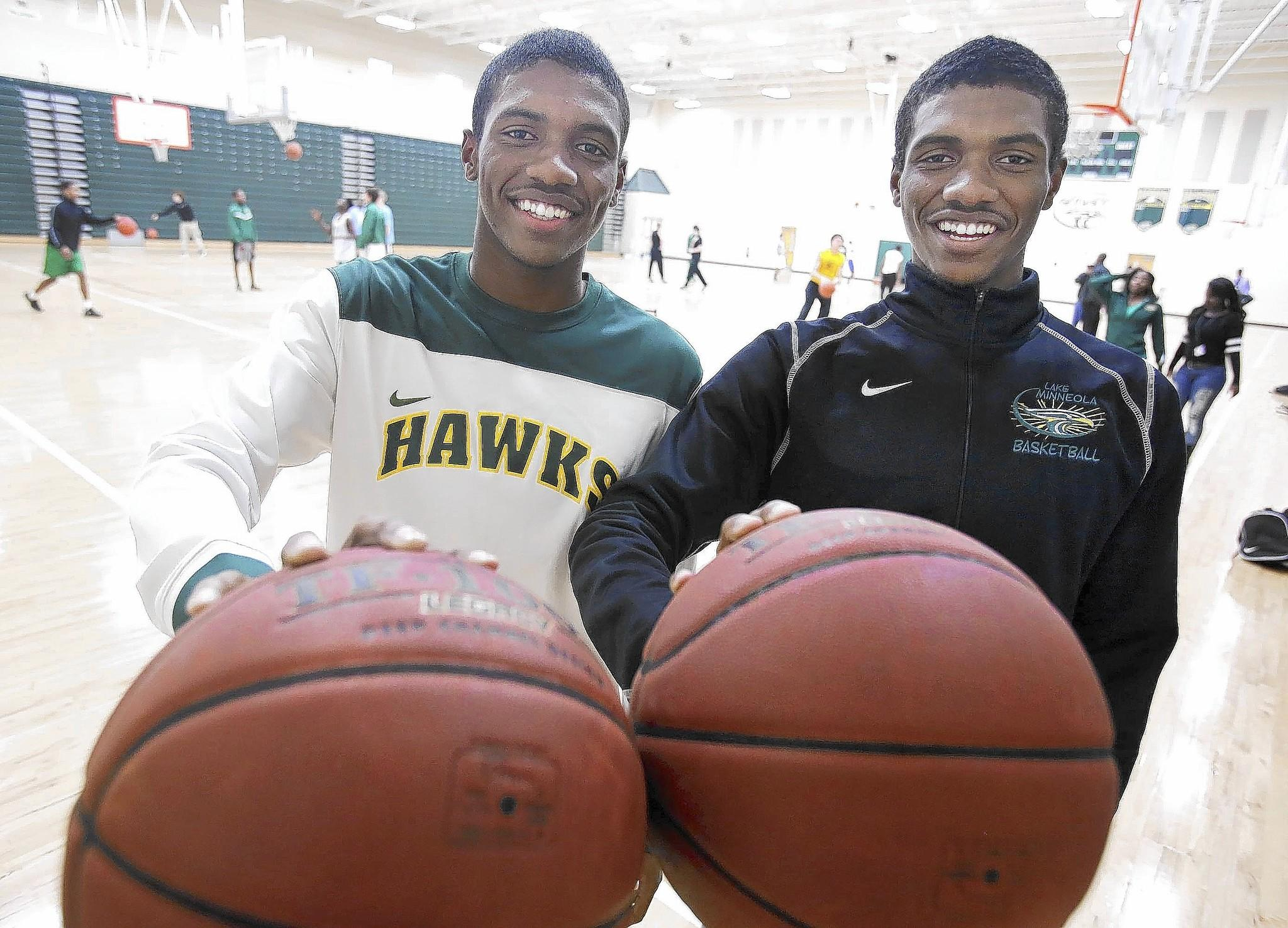 Identical twin brothers Anthony (left) and Avery Brown (right) are pictured during basketball practice at Lake Minneola High School in Minneola on Tuesday, January 121, 2014. (Stephen M. Dowell/Orlando Sentinel)