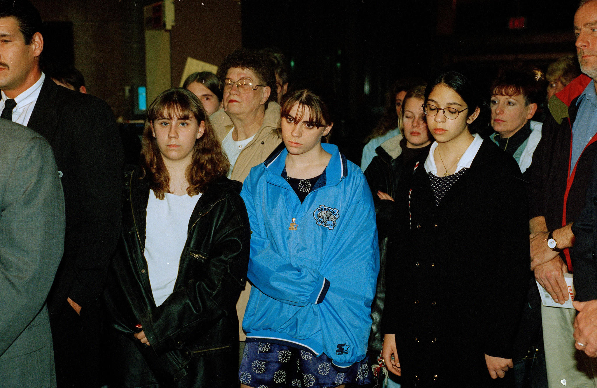 Sarah Sanaghan, 13, center in bright blue jacket, stands as someone else talks to reporters on Nov. 4, 1997 after a Will County jury convicted Richard Devon in the hit-and-run that injured her and killed her twin sister, Cari, Courtney Lauer, and Sheena Acres.