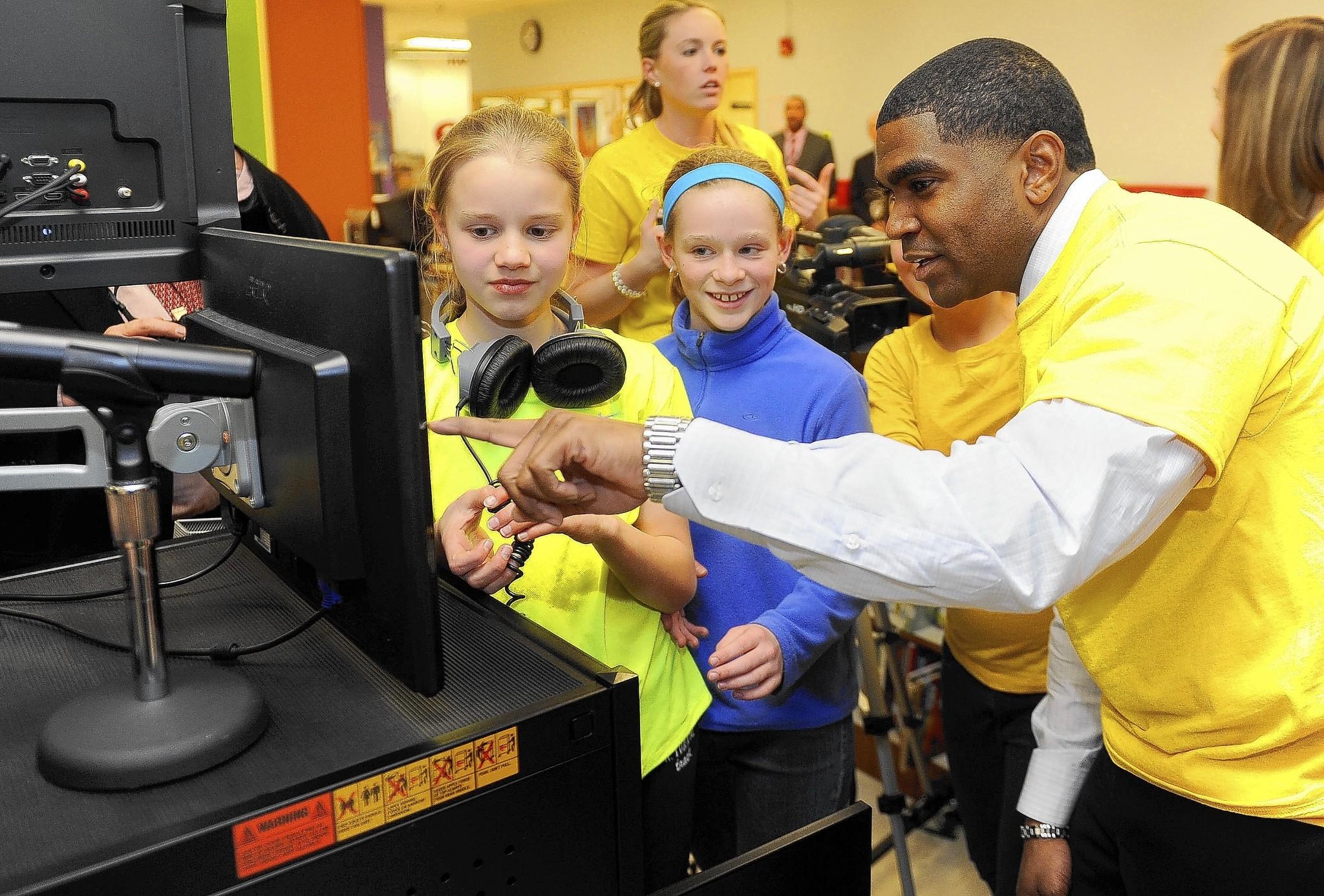 "Dr. Dallas Dance, who is the superintendent of Baltimore County Schools, visits Rodgers Forge Elementary School, which has been named a Lighthouse School. Here, he looks at a television monitor with fifth graders Ellie Proutt, left, and Sydney Ballenger, center, who work for the school's ""Today"" show. He was the guest on the school's show this afternoon."