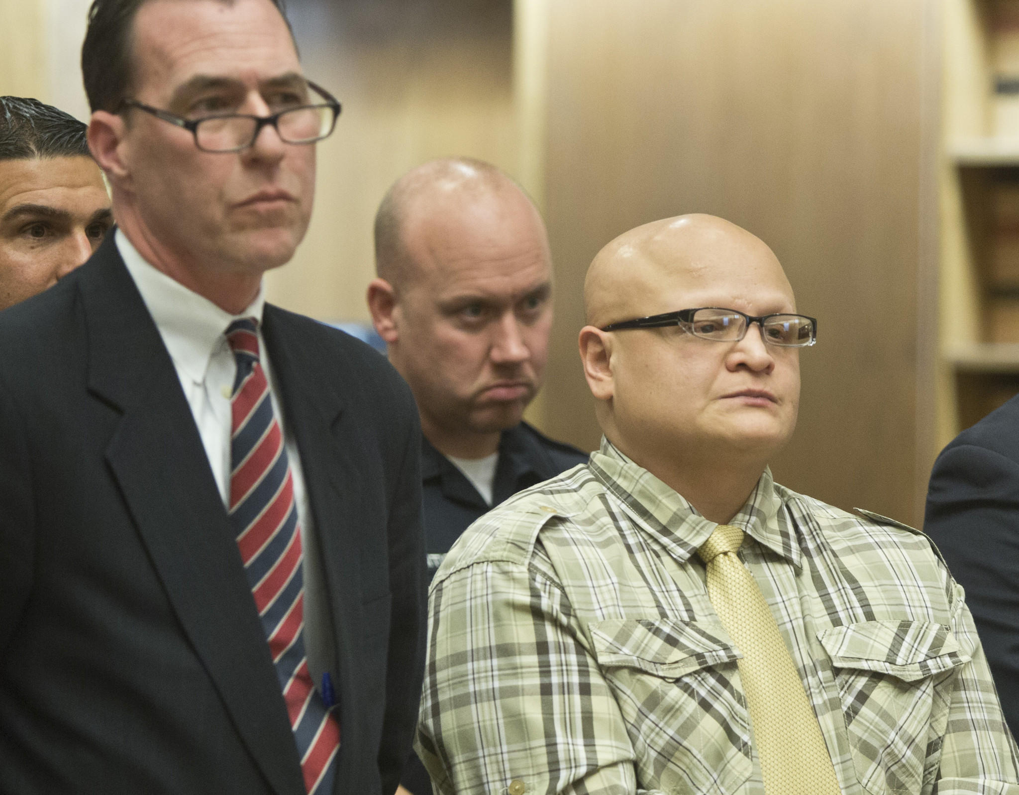 Frankie Resto, at right, standing next to his attorney Glenn Conway, receives a sentence of 53 years in prison for the murder of Ibrahim Ghazal from Judge Patrick Clifford at Superior Court in New Haven, Friday, Feb. 28, 2014. | Christopher Zajac / Record-Journal