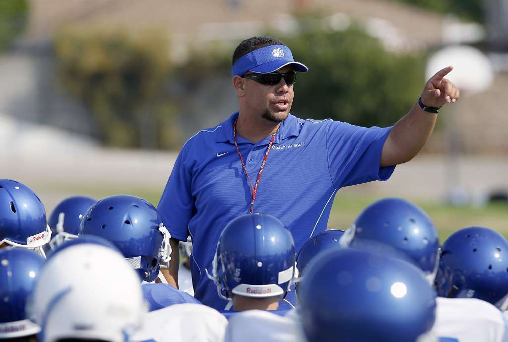 Burbank High varsity head football coach Hector Valencia, shown here in 2009, is stepping down after five years with the Bulldogs. Valencia posted a 37-20 record, while his team won a Pacific League title in 2009. (Raul Roa/File Art)