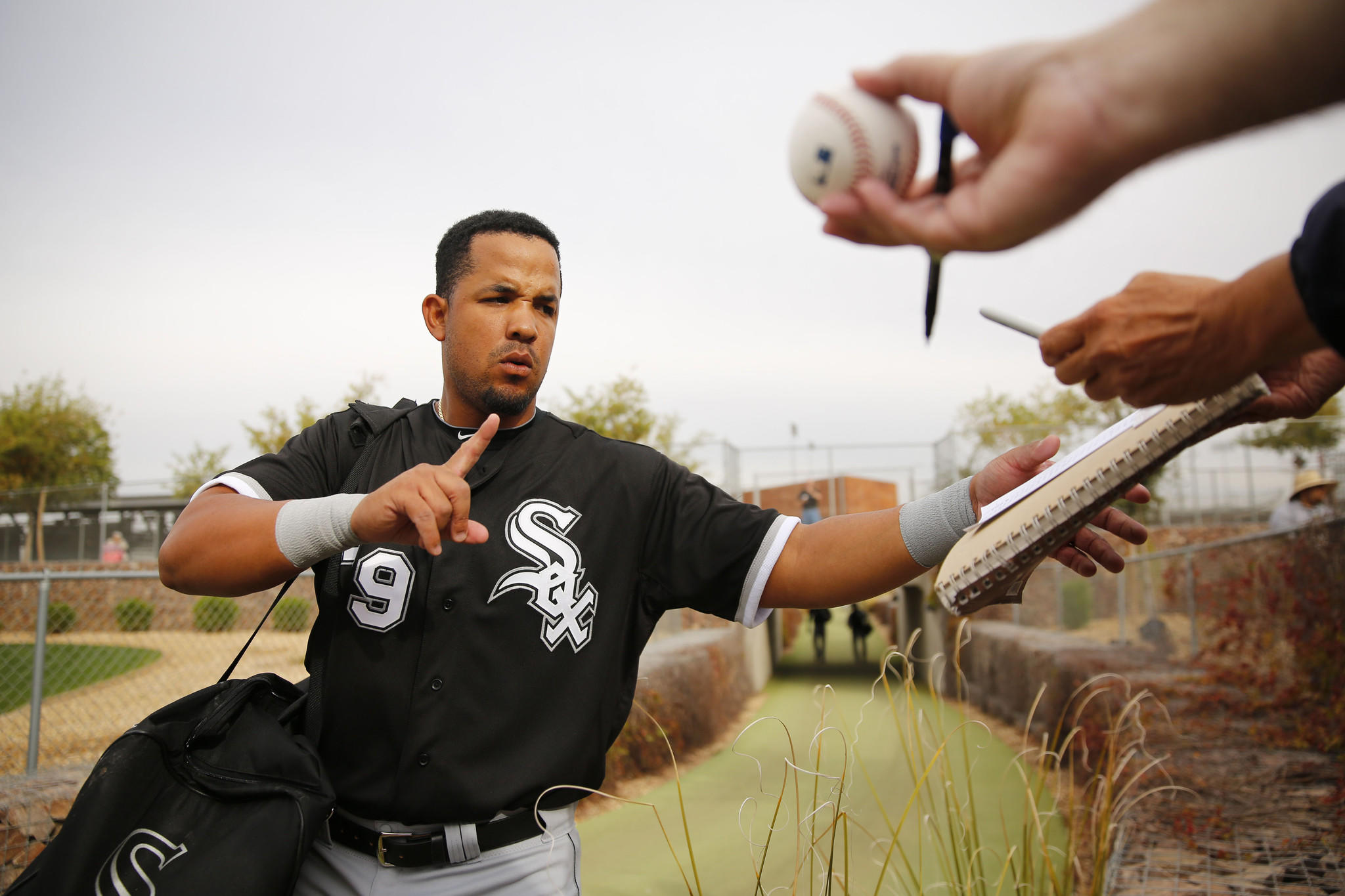 White Sox infielder Jose Abreu signals he'll sine just one more autograph Tuesday, Feb. 25, 2014 in Glendale prior to an intrasquad practice game Tuesday, Feb. 25, 2014 in Glendale, Arizona.