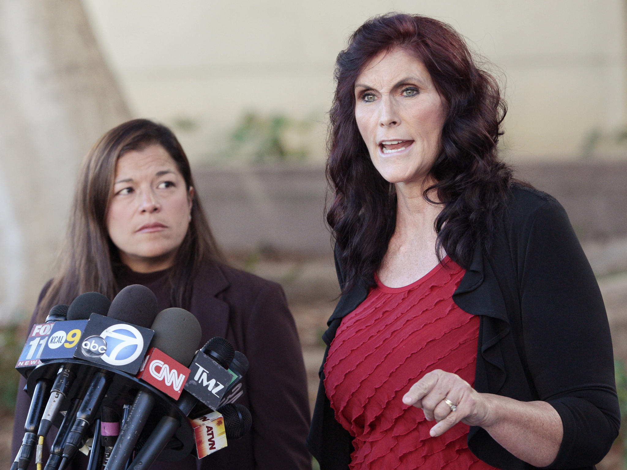 "This Sept. 20, 2012, photo shows Cindy Lee Garcia, right, one of the actresses in the film ""Innocence of Muslims,"" and attorney M. Cris Armenta at a news conference before a Superior Court hearing in Los Angeles. A federal appeals court ordered YouTube on Wednesday to take down an anti-Muslimfilm that sparked violence in many parts of the Middle East."