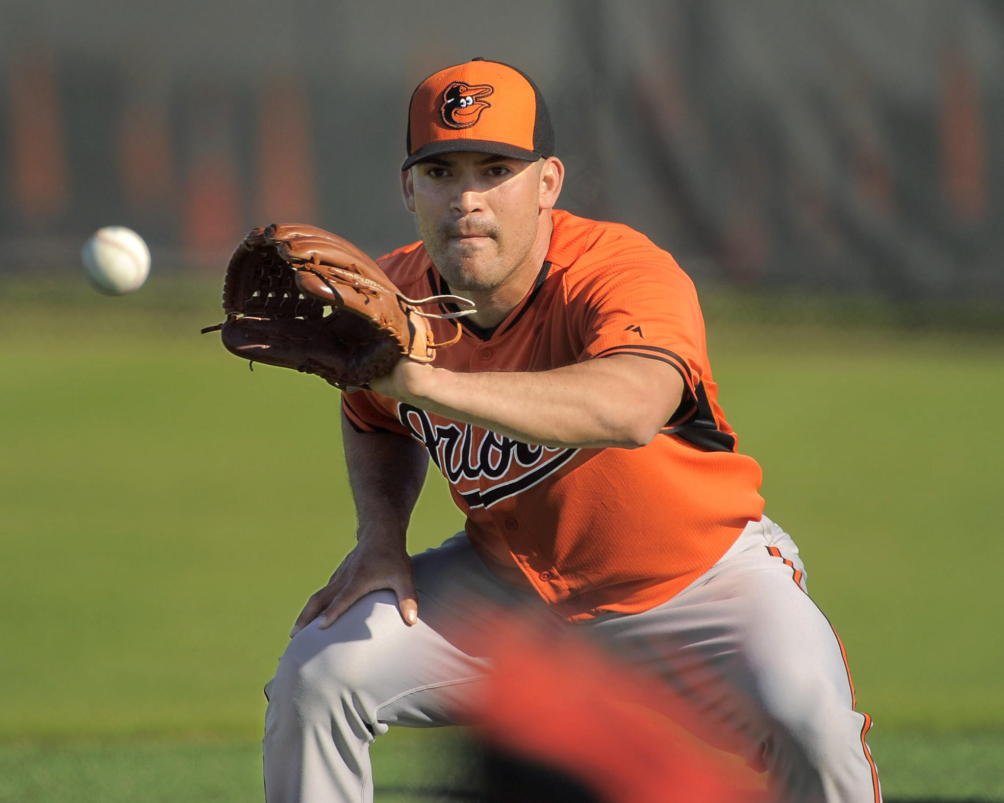 Baltimore Orioles pitcher Eddie Gamboa warms up during workouts at the Orioles' spring training facility.