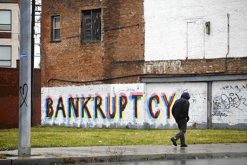 A man walks past graffiti in Detroit, Michigan in this 2013 file photo.