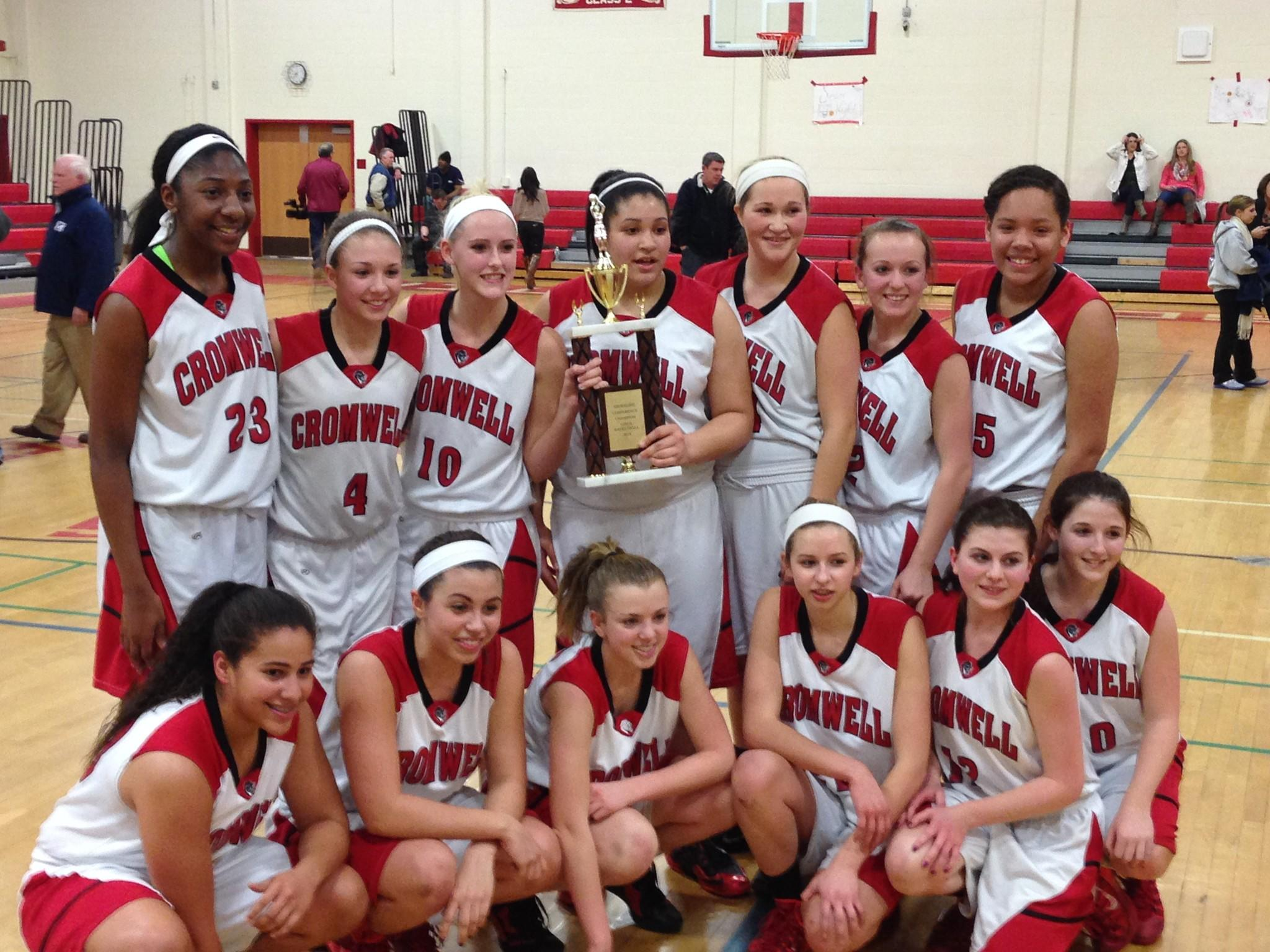 Cromwell poses with the trophy after winning the Shoreline Conference girls basketball tournament.
