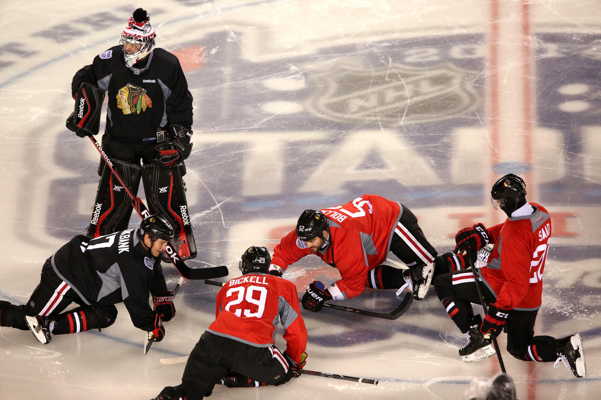 Members of the Chicago Blackhawks stretch during practice.