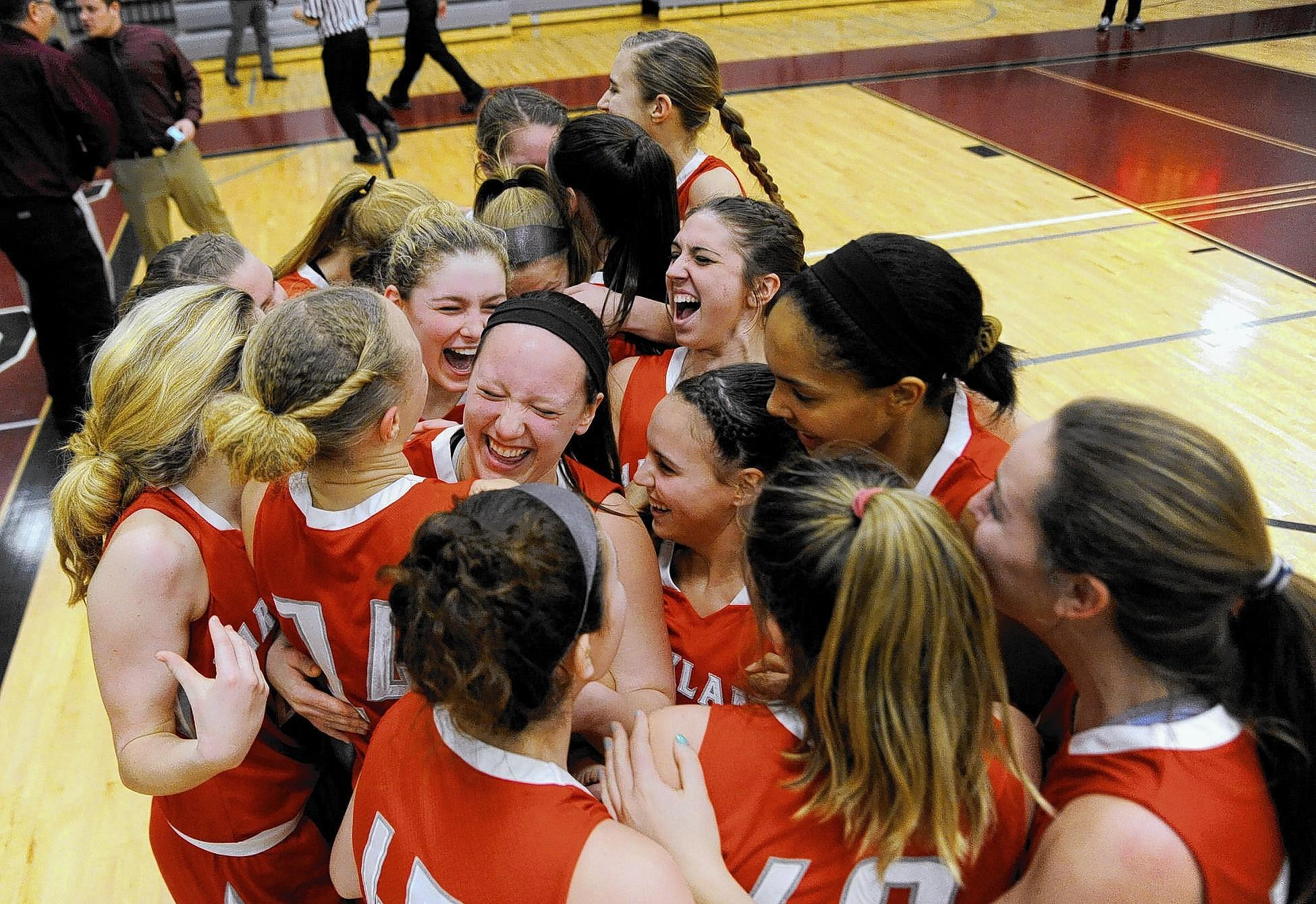 Parkland girls basketball players celebrate after winning the championship game against Pocono Mountain West Friday night at Stroudsburg High School.