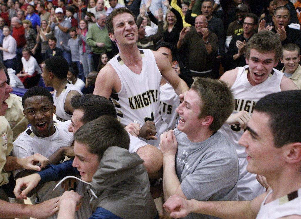 The St. Francis High boys' basketball team celebrates after beating La Cañada in a CIF-SS Division III-A semifinal game played at Maranatha High in Pasadena on Friday. (Tim Berger/Staff Photographer)