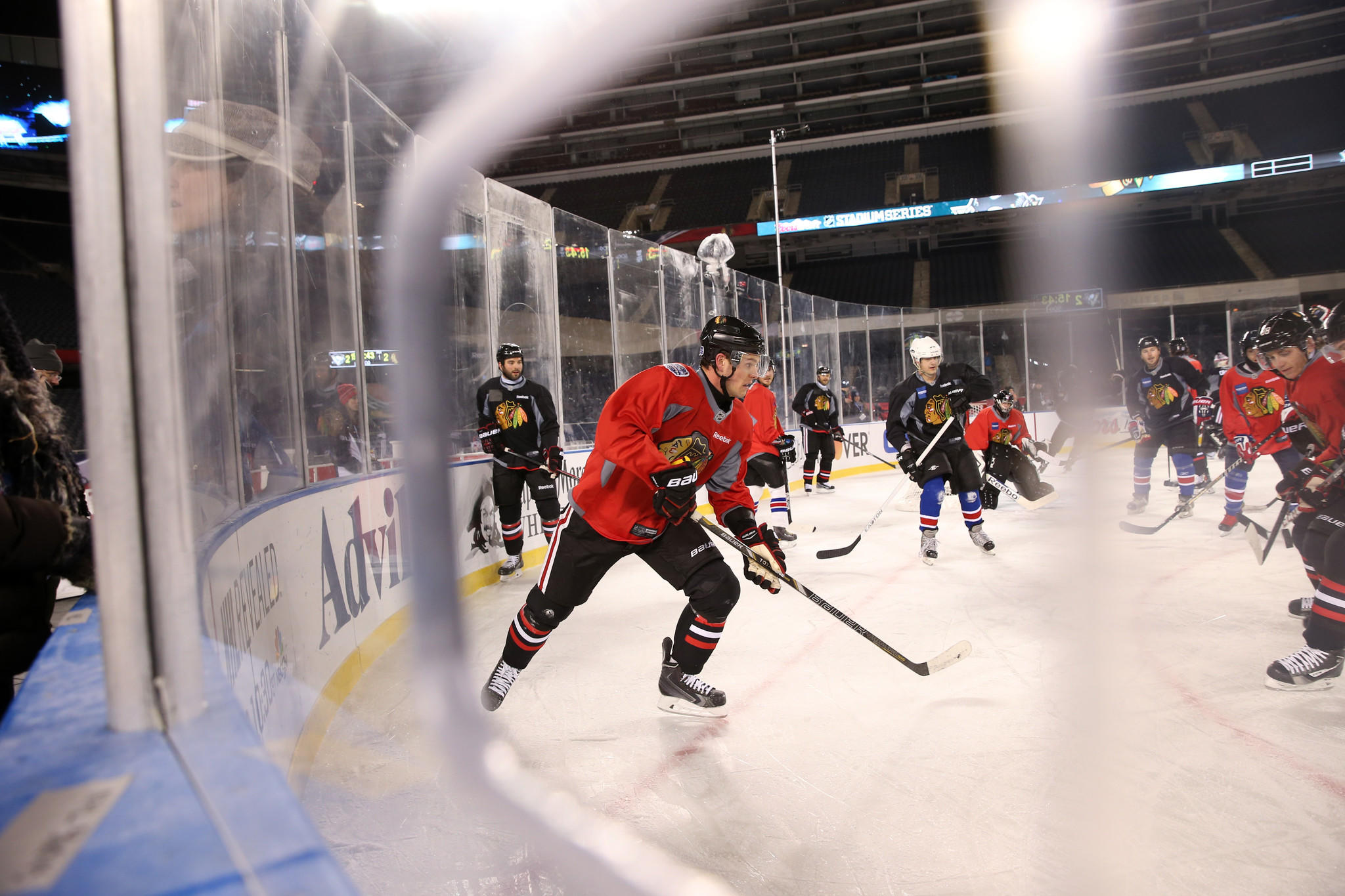 Center Jonathan Toews (19) and other Chicago Blackhawks skate with Wounded Warriors Project hockey players following a practice at Soldier Field.
