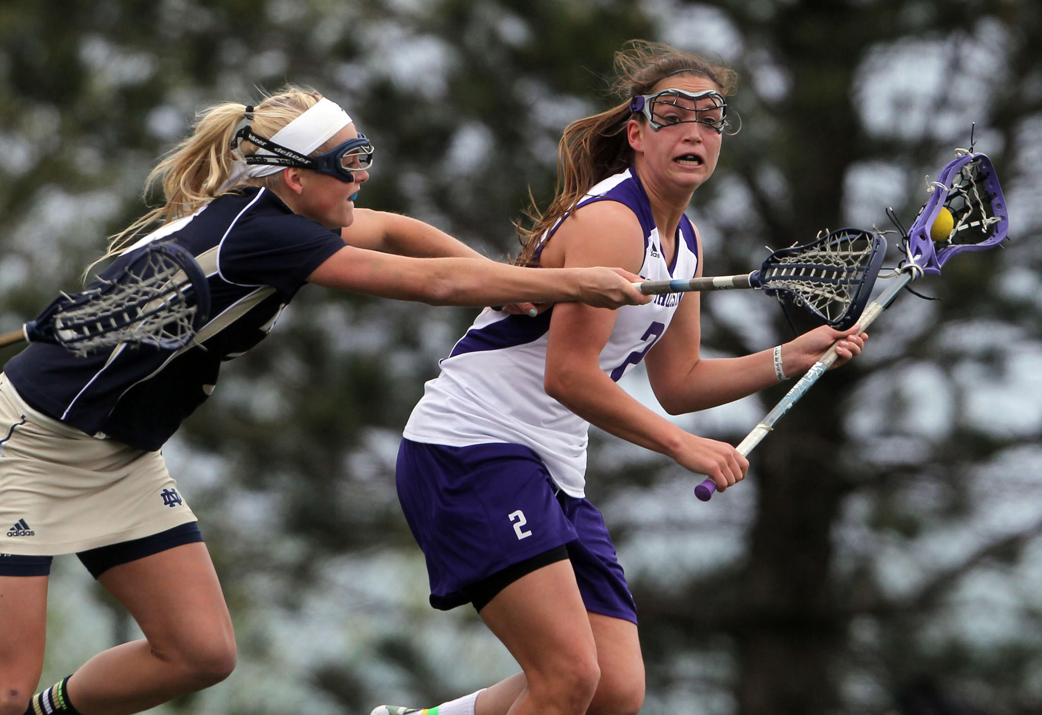 Northwestern's Alyssa Leonard (with ball) is near the NCAA record for draw controls.