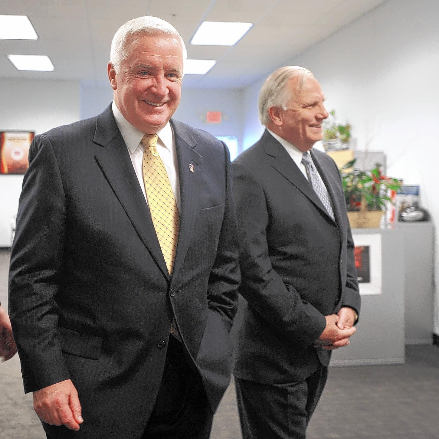 State Sen. Bob Mensch, R-Montgomery (right), shown with Gov. Tom Corbett during a 2012 visit to Palmer Township, has a bill to force everyone to use alternative electricity suppliers.