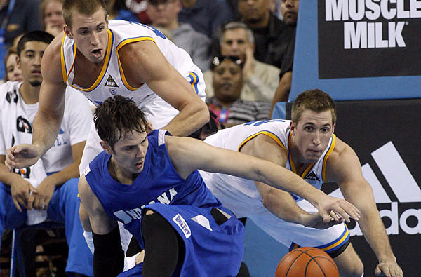 UCLA forwards Travis, left, and David Wear battle for a loose ball against Indiana State forward R.J. Mahurin during a game last season at Pauley Pavilion.