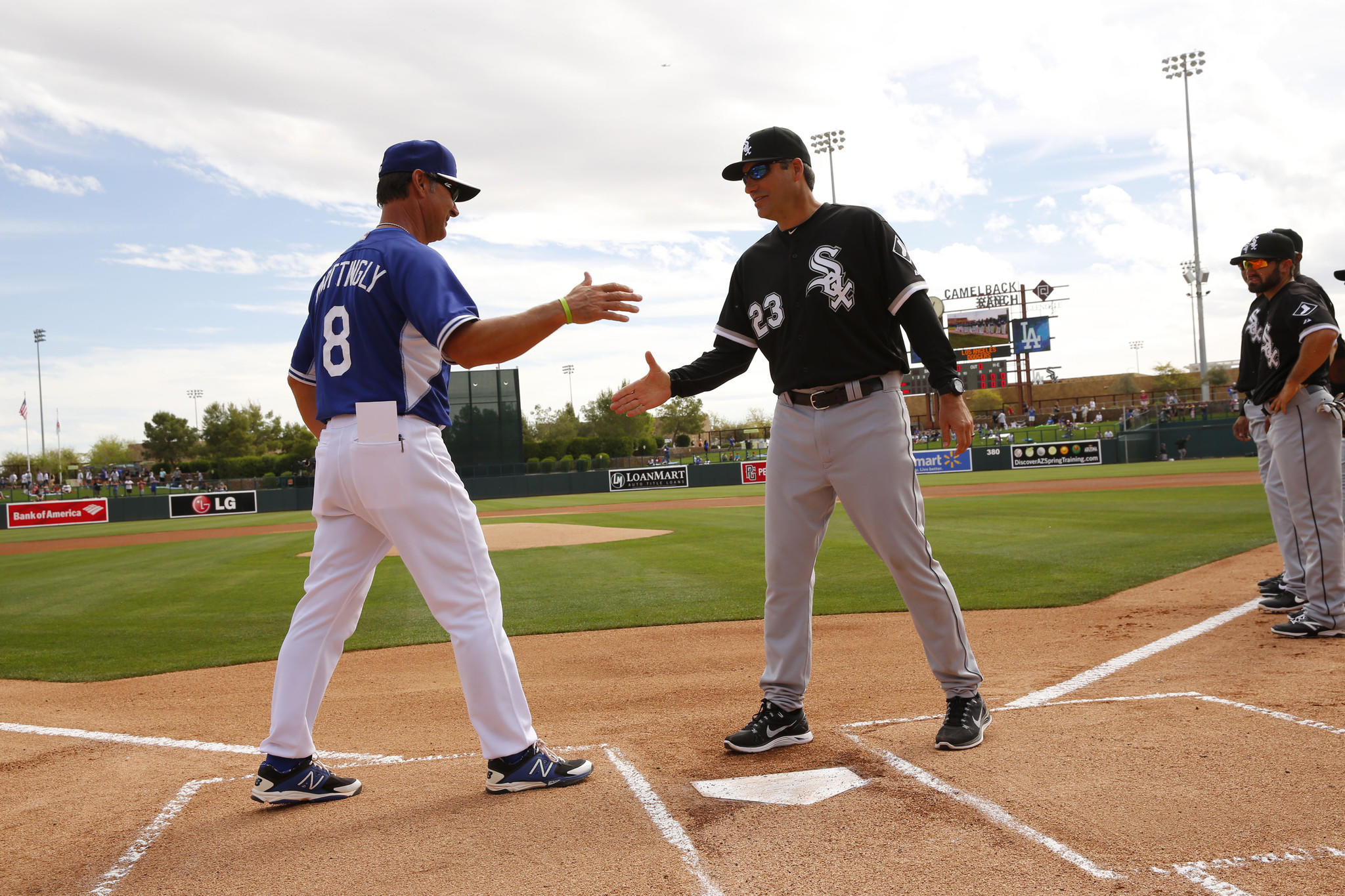 Los Angeles Dodgers Manager Don Mattingly, left, and White Sox Manager Robin Ventura shake hands Friday, Feb. 28, 2014 during the White Sox spring training opening day ceremonies at Camelback Ranch stadium in Glendale, Arizona.